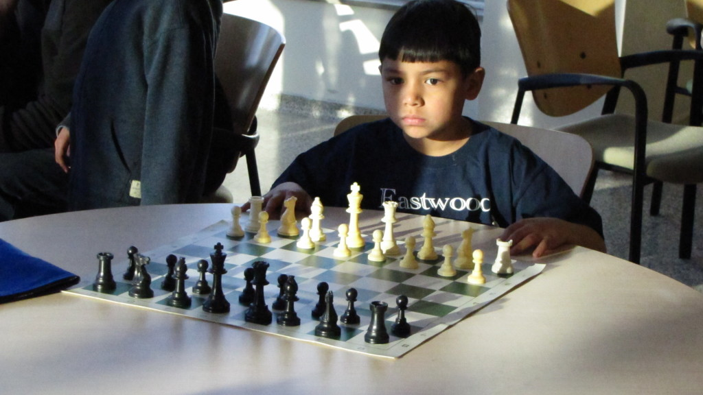 child at a chess set in Salt Lake City