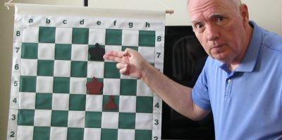 king-and-pawn chess endgame demonstrated by chess coach Jonathan Whitcomb
